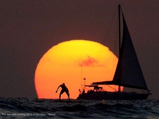 The sun sets ending 2013 in Honolulu, Hawaii