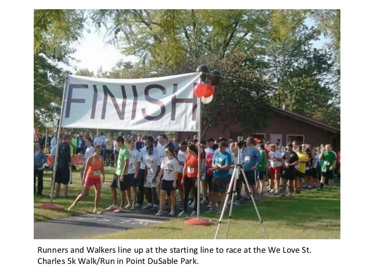 Runners and Walkers line up at the starting line to race at the We Love St.Charles 5k Walk/Run in Point DuSable Park.