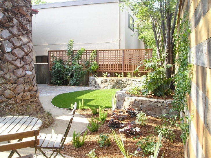 contempory small backyard with sitting area