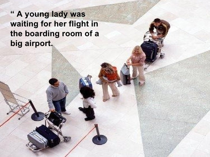"""""""  A young lady was waiting for her flight in the boarding room of a big airport."""