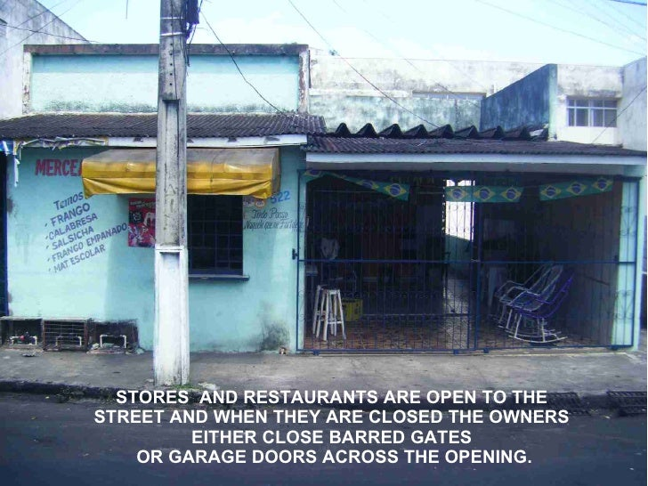 STORES AND RESTAURANTS ARE OPEN TO THE STREET AND WHEN THEY ARE CLOSED THE OWNERS          EITHER CLOSE BARRED GATES     O...