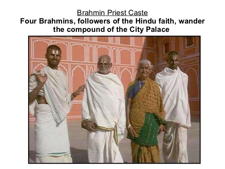 Brahmin Priest Caste Four Brahmins, followers of the Hindu faith, wander the compound of the City Palace