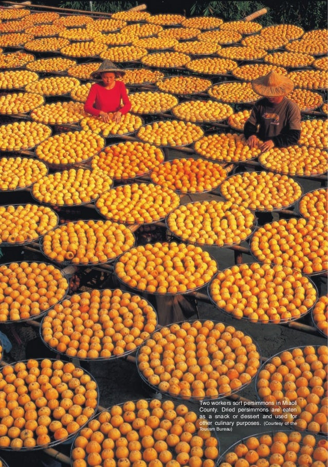 Two workers sort persimmons in Miaoli                                      County. Dried persimmons are eaten             ...