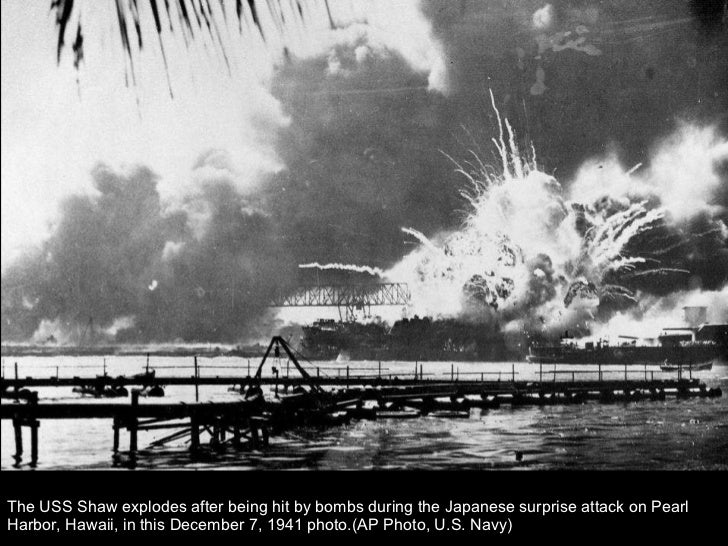 The USS Shaw explodes after being hit by bombs during the Japanese surprise attack on Pearl Harbor, Hawaii, in this Decemb...