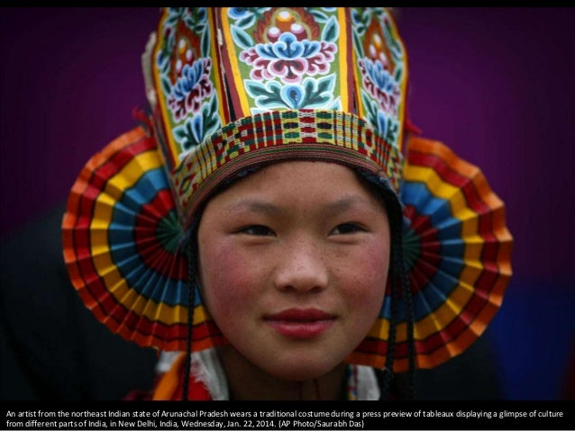 An artist from the northeast Indian state of Arunachal Pradesh wears a traditional costume during a press preview of table...