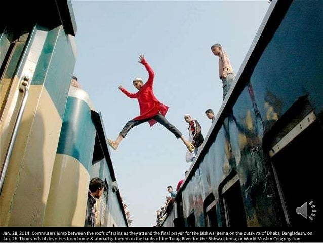 Jan. 28, 2014: Commuters jump between the roofs of trains as they attend the final prayer for the Bishwa Ijtema on the out...