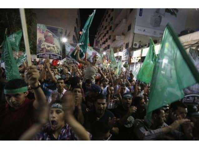 Palestinians celebrate victory by Palestinians in Gaza over Israel