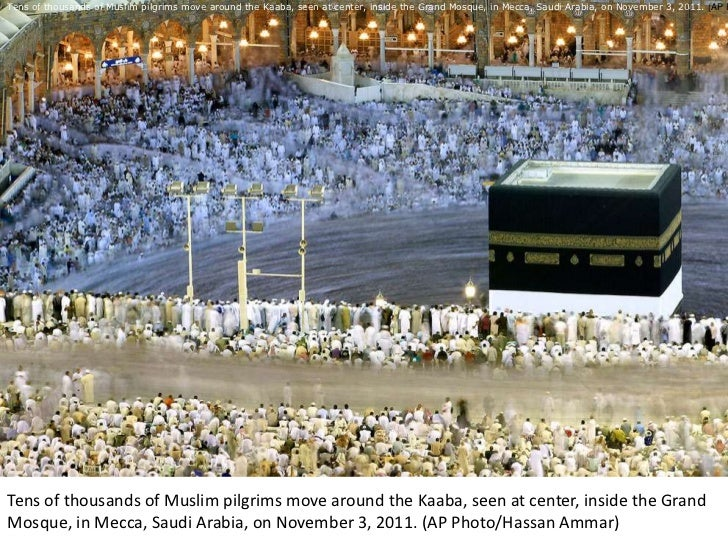 Tens of thousands of Muslim pilgrims move around the Kaaba, seen at center, inside the Grand Mosque, in Mecca, Saudi Arabi...