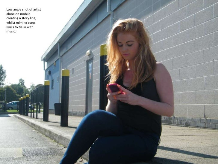 Low angle shot of artist alone on mobile creating a story line, whilst miming song lyrics to tie in with music. <br />