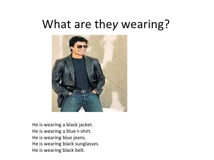 What are the y  wearing? He is wearing a black jacket. He is wearing a blue t-shirt. He is wearing blue jeans. He is weari...