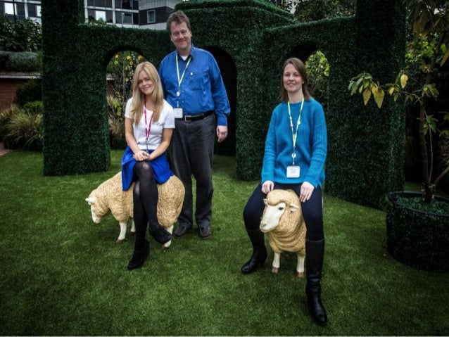 Laura, Martin and Lou sitting on some toy sheep at the British Library