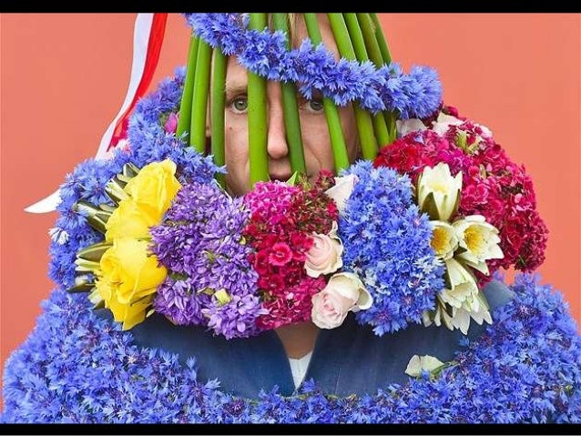 A young Sorb looks through a bonnet made of cornflowers and water lilies as he embodies the ''Johannis'' (John) for the tr...