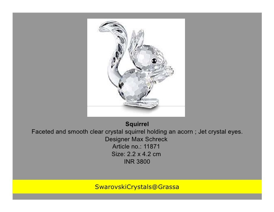 SquirrelFaceted and smooth clear crystal squirrel holding an acorn ; Jet crystal eyes.                         Designer Ma...