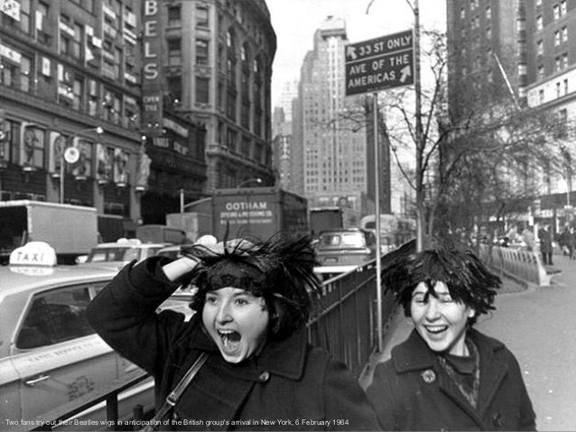 Two fans try out their Beatles wigs in anticipation of the British group's arrival in New York, 6 February 1964