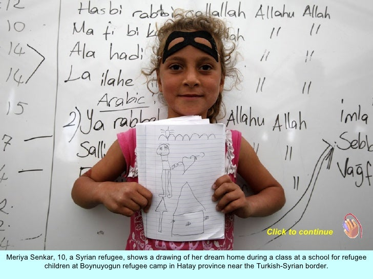 Click to continueMeriya Senkar, 10, a Syrian refugee, shows a drawing of her dream home during a class at a school for ref...