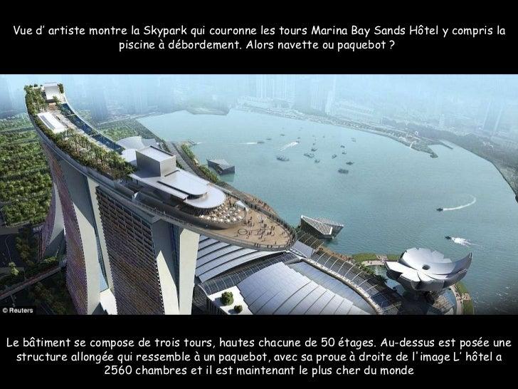 Le bâtiment se compose de trois tours, hautes chacune de 50 étages. Au-dessus est posée une structure allongée qui ressemb...