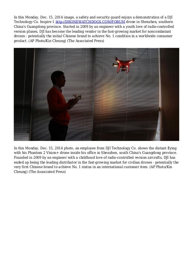 In this Monday, Dec. 15, 2014 image, a safety and security guard enjoys a demonstration of a DJI Technology Co. Inspire 1 ...