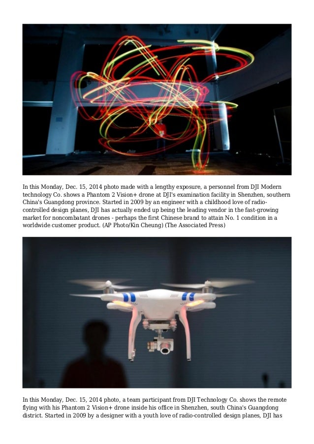 In this Monday, Dec. 15, 2014 photo made with a lengthy exposure, a personnel from DJI Modern technology Co. shows a Phant...