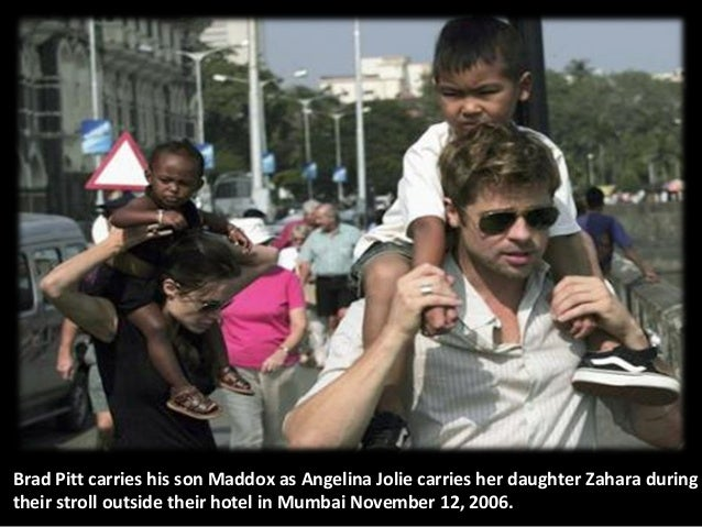 Brad Pitt carries his son Maddox as Angelina Jolie carries her daughter Zahara during their stroll outside their hotel in ...