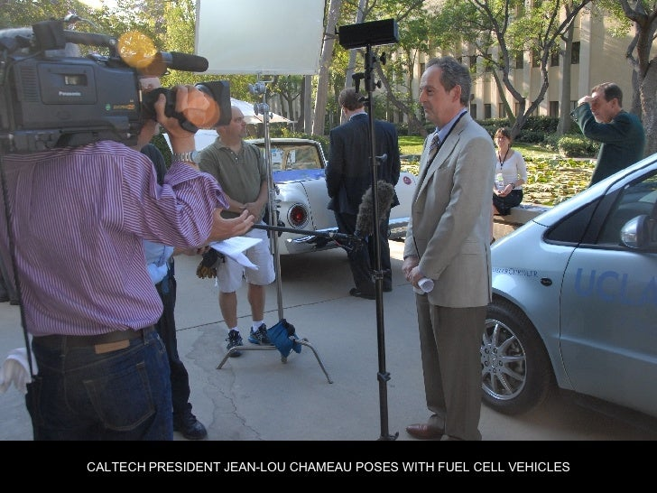 CALTECH PRESIDENT JEAN-LOU CHAMEAU POSES WITH FUEL CELL VEHICLES