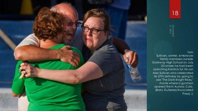 18                           Tom   Sullivan, center, embraces      family members outsideGateway High School on July      ...