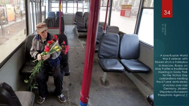 34     A lone Russian World       War II veteran withflowers sits in a trolleybus    in Moscow, Russia, onMay 9 after a tr...