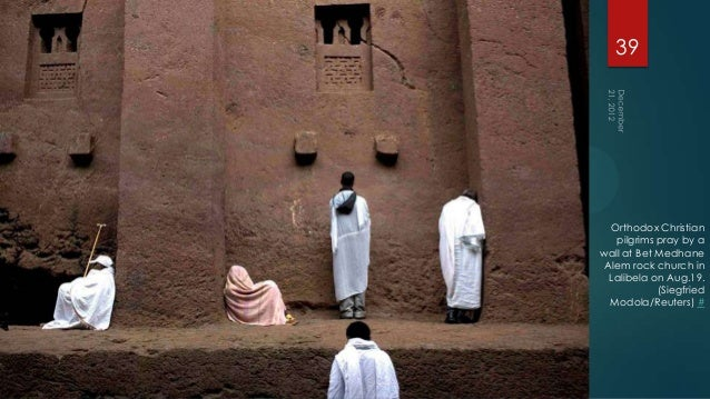 39  Orthodox Christian   pilgrims pray by awall at Bet Medhane Alem rock church in  Lalibela on Aug.19.            (Siegfr...