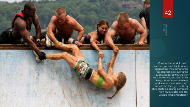 42      Competitors work to pull a woman up an obstacle where   competitors must jump to the    top of a half pipe during ...