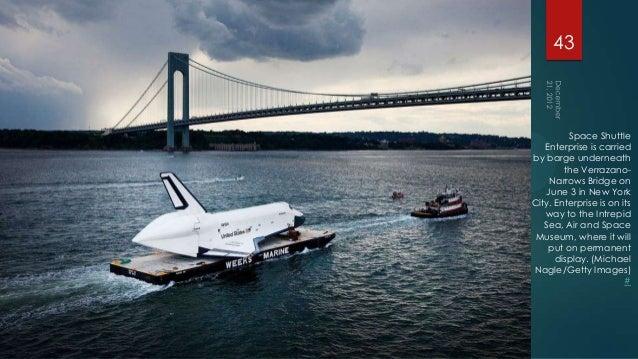 43         Space Shuttle   Enterprise is carriedby barge underneath        the Verrazano-    Narrows Bridge on   June 3 in...