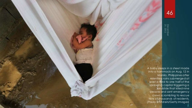 46A baby sleeps in a sheet made into a hammock on Aug. 12 in          Manila, Philippines after    relentless rains submer...