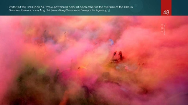Visitors of the Holi Open Air, throw powdered color at each other at the riverside of the Elbe inDresden, Germany, on Aug....