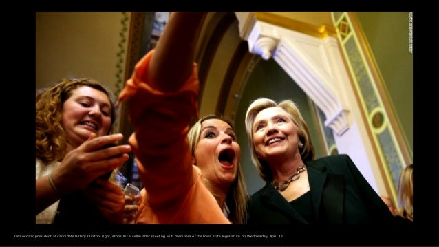 Democratic presidential candidate Hillary Clinton, right, stops for a selfie after meeting with members of the Iowa state ...