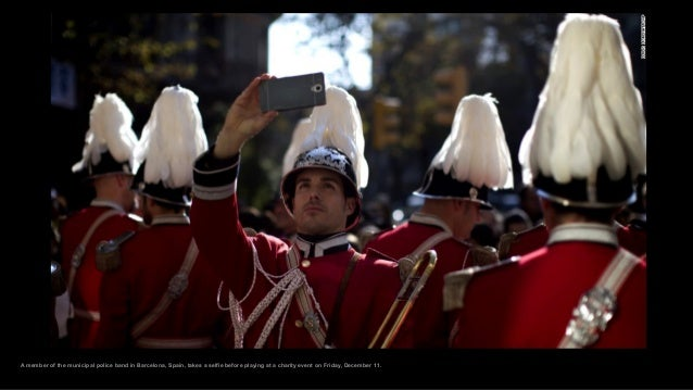 A member of the municipal police band in Barcelona, Spain, takes a selfie before playing at a charity event on Friday, Dec...