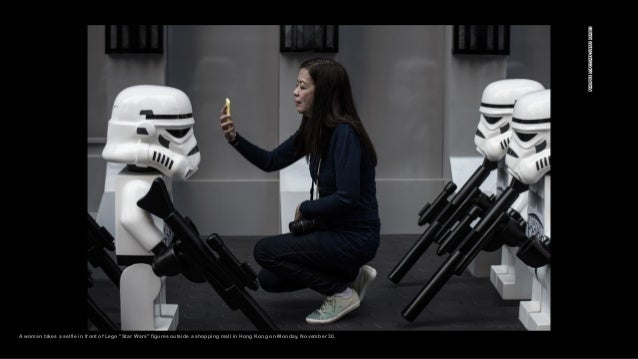 """A woman takes a selfie in front of Lego """"Star Wars"""" figures outside a shopping mall in Hong Kong on Monday, November 30."""