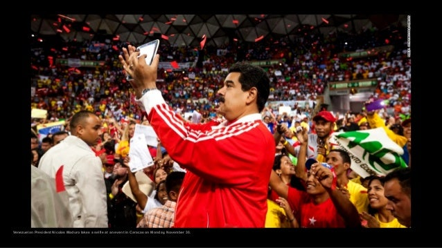 Venezuelan President Nicolas Maduro takes a selfie at an event in Caracas on Monday, November 30.