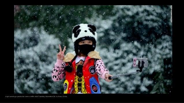 A girl wearing a panda hat uses a selfie stick Tuesday, November 24, in Jinan, China.