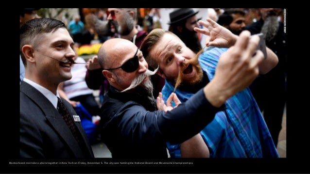 Mustachioed men take a photo together in New York on Friday, November 6. The city was hosting the National Beard and Moust...