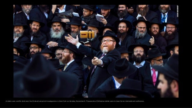 A rabbi uses a selfie stick near the Chabad-Lubavitch headquarters in New York on Sunday, November 8. Thousands of Orthodo...