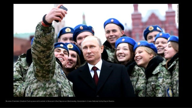 Russian President Vladimir Putin poses with cadets in Moscow's Red Square on Wednesday, November 4. It was National Unity ...