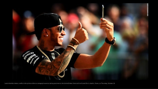 Lewis Hamilton takes a selfie in the pit lane after an autograph session during previews to the United States Formula One ...