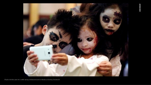 Filipino children pose for a selfie during a Halloween event in Manila on Sunday, October 25.