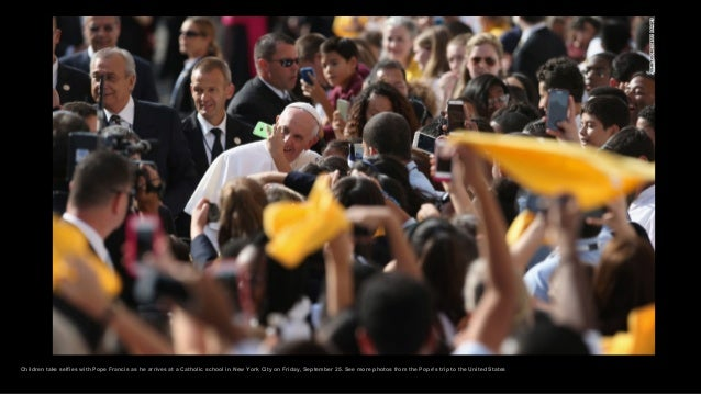 Children take selfies with Pope Francis as he arrives at a Catholic school in New York City on Friday, September 25. See m...