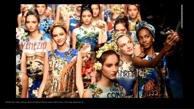 Models take selfies during a Dolce & Gabbana fashion show in Milan, Italy, on Sunday, September 27.
