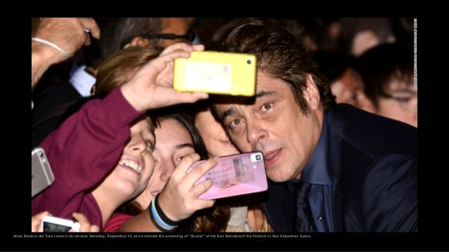 """Actor Benicio del Toro leans in for photos Saturday, September 19, as he attends the screening of """"Sicario"""" at the San Seb..."""