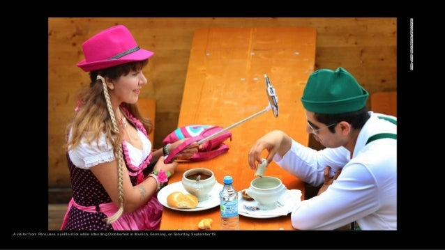 A visitor from Peru uses a selfie stick while attending Oktoberfest in Munich, Germany, on Saturday, September 19.