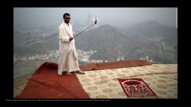 A Muslim pilgrim atop Mount Thor uses a selfie stick Saturday, September 19, ahead of the annual Hajj pilgrimage in Mecca,...