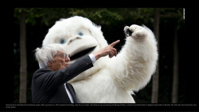 Formula One chief Bernie Ecclestone poses with a person in a Yeti costume Thursday, July 16, in London. Ecclestone was pro...