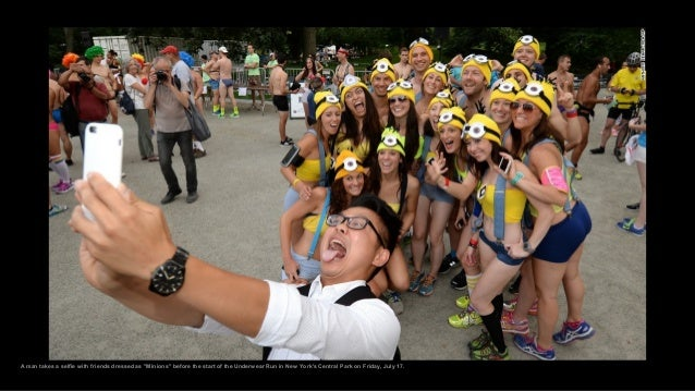 """A man takes a selfie with friends dressed as """"Minions"""" before the start of the Underwear Run in New York's Central Park on..."""