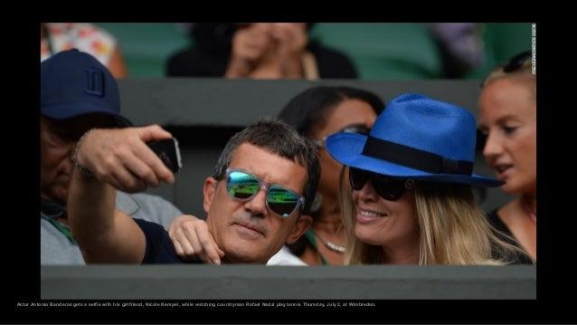 Actor Antonio Banderas gets a selfie with his girlfriend, Nicole Kempel, while watching countryman Rafael Nadal play tenni...