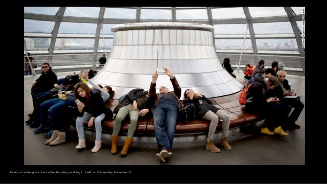 Tourists visit the glass dome of the Reichstag building in Berlin on Wednesday, December 23.